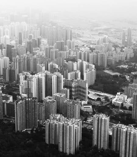 Aerial photo of a city, Photo by Pop & Zebra on Unsplash